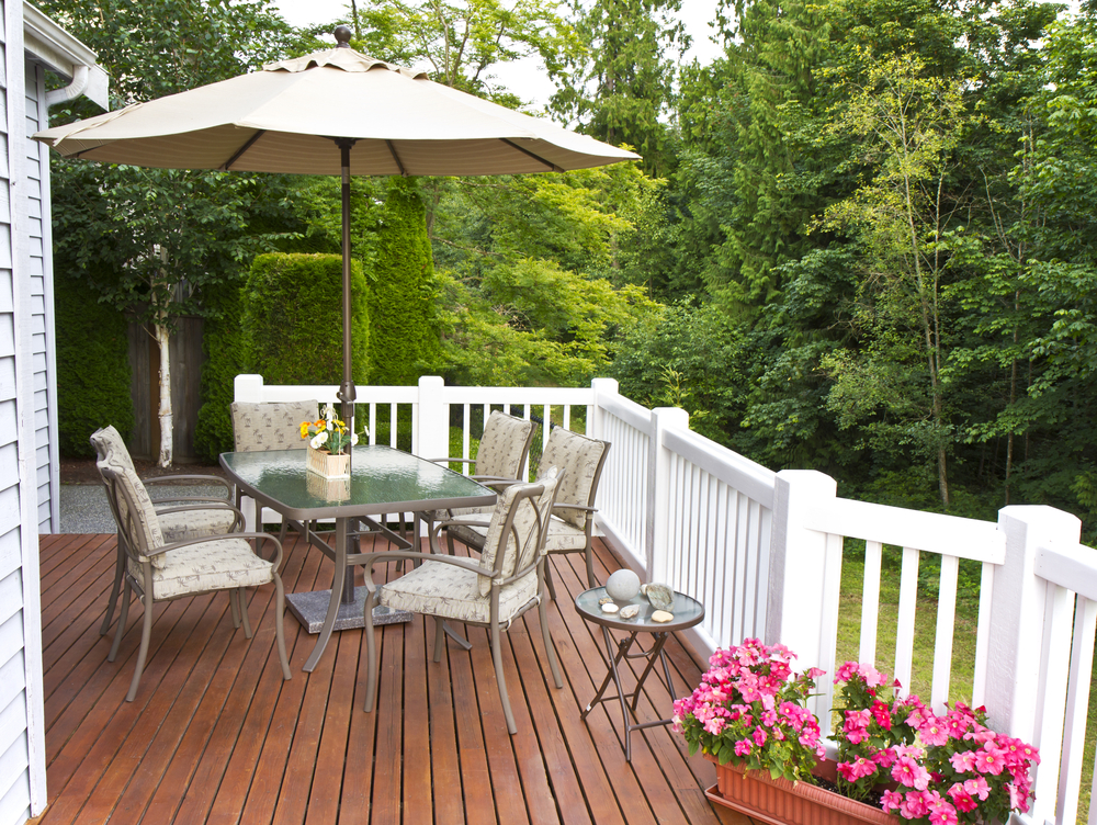 furniture and flowers on a deck